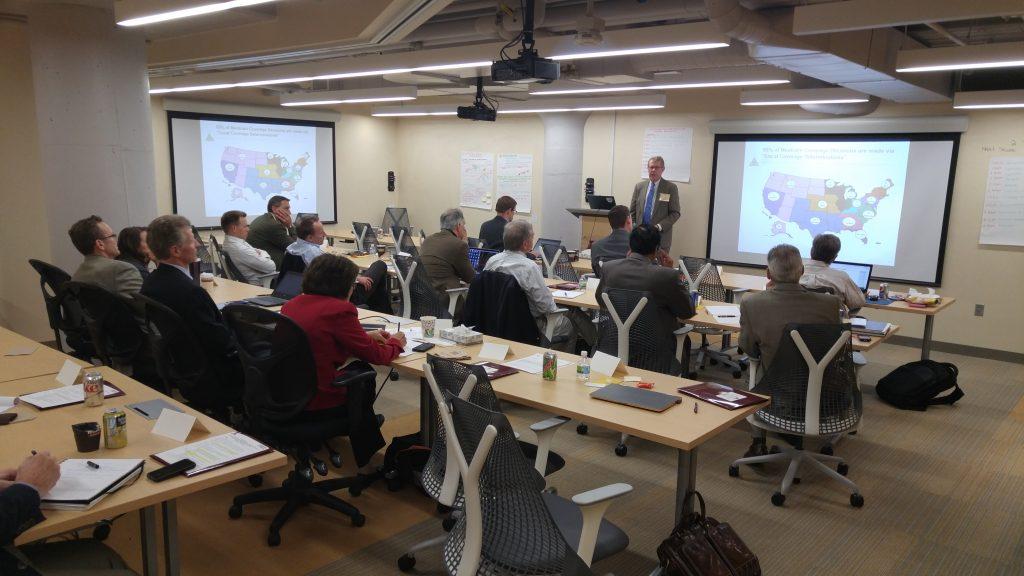 Workshop participants listening to a speaker